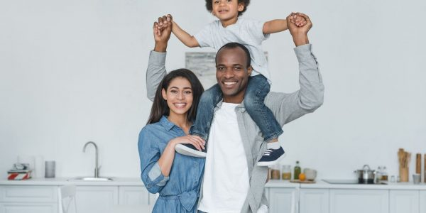 happy-african-american-parents-and-son-at-home-min